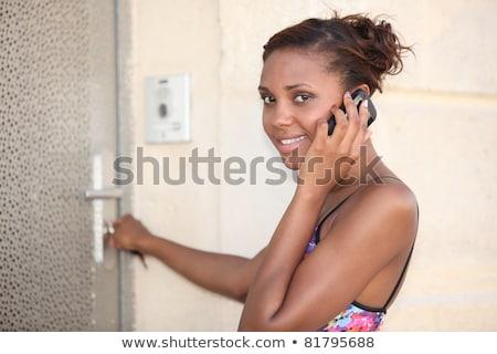 Woman unlocking her frontdoor Stock photo © photography33
