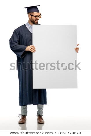 Man in graduation robe holding blank board Stock photo © photography33