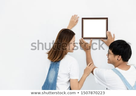 woman holding a picture frame stock photo © photography33