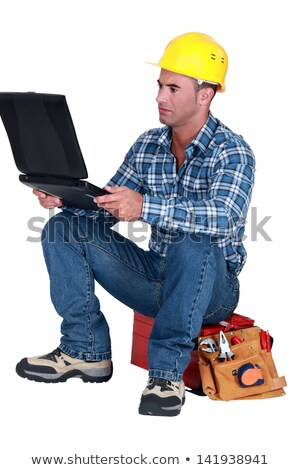 Distraught tradesman reading his emails Stock photo © photography33