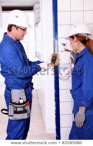 Supervisor explaining work to female electrician apprentice Stock photo © photography33