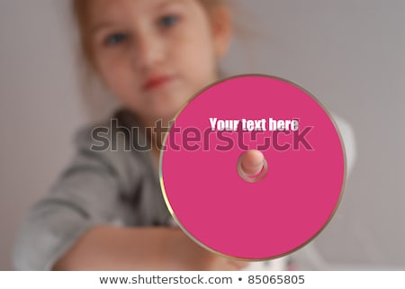 blond girl holding cd stock photo © photography33