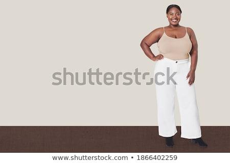 femme · sans · manches · spaghettis · haut · posant - photo stock © stockyimages