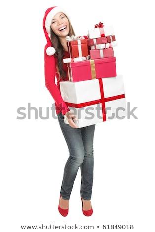 Full body Christmas woman holding gift wearing Santa hat. Stock photo © szefei
