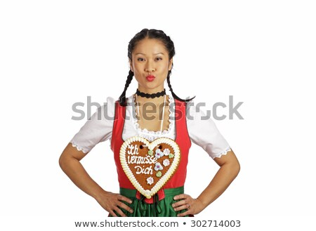 Asian Woman with Bavarian gingerbread heart Stock photo © Kzenon