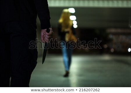 Man with knife threatening a woman Stock photo © michaklootwijk