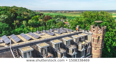 Church with solar panels Stock photo © elxeneize