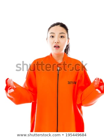 young asian woman shrugging in prisoners uniform stock photo © bmonteny