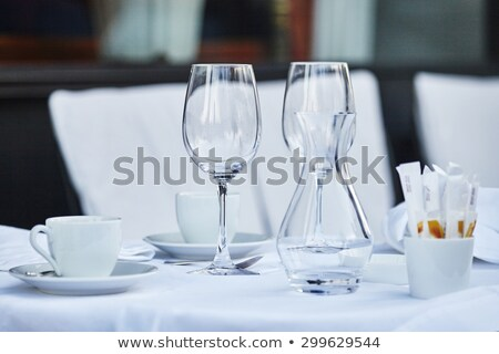 Dining table with the empty coffee cups and glasses Stock photo © amok