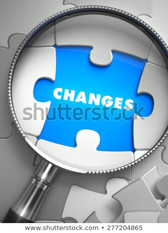 Changes - Puzzle with Missing Piece through Loupe. Stock photo © tashatuvango