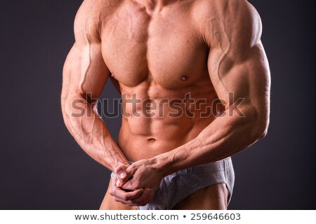 Muscular homem posando sem camisa preto Foto stock © wavebreak_media