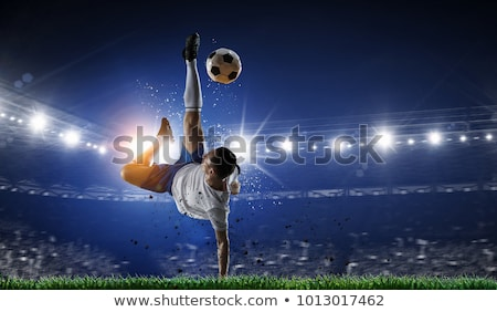 Soccer player heading a soccer ball Stock photo © imagedb