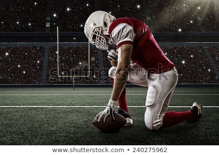 Determined football player Stock photo © alphaspirit