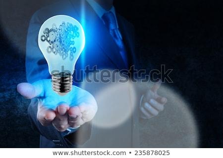 Villanykörte sebességváltó fogaskerekek férfi kéz technológia Stock fotó © tetkoren