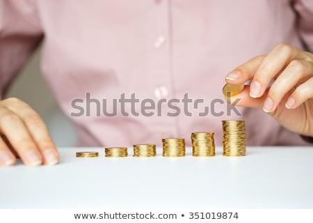 Homme main pièces d'or colonnes économies femme Photo stock © vlad_star