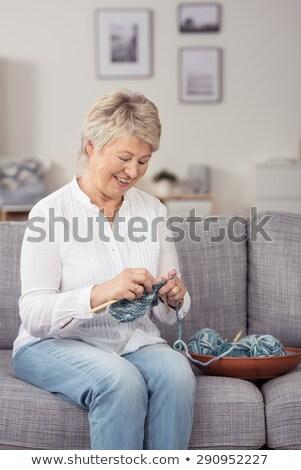 Grandma sitting at home doing her knitting Stock photo © ozgur