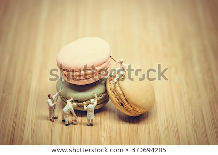 Miniature painters coloring macaroon. Color tone tuned. Stock photo © Kirill_M
