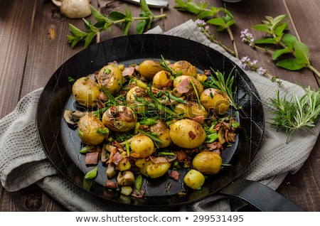 New potatoes and sauteed vegetables Stock photo © Digifoodstock