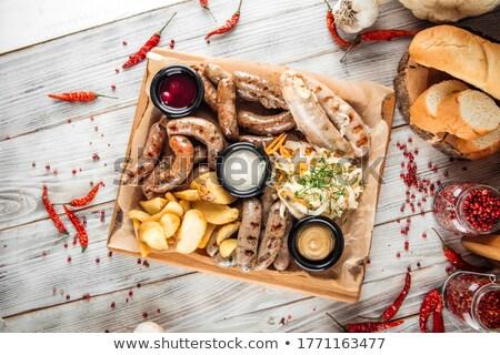 Kolbász savanyú káposzta pörkölt étel közelkép főtt Stock fotó © Digifoodstock