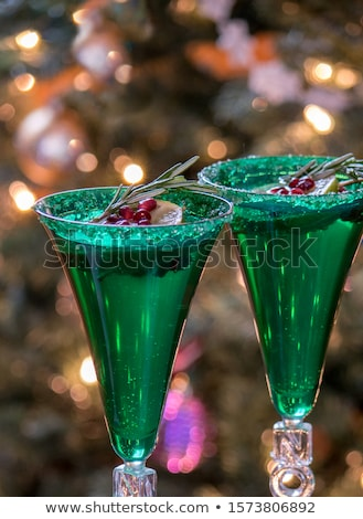 Two glasses of champagne with pomegranate seeds Stock photo © Alex9500