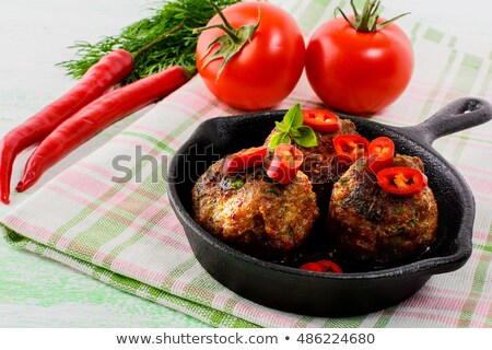 Beef meatballs with chili pepper  served in skillet  Stock photo © TasiPas