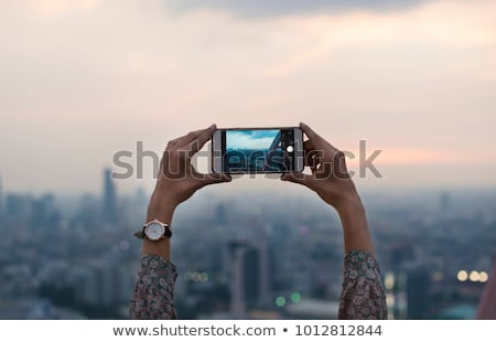 Hand Using Mobile Phone To Capture City Building Stock photo © AndreyPopov