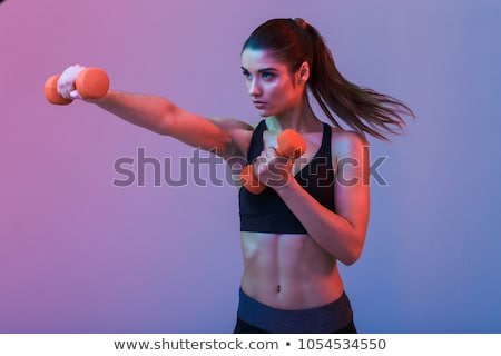 Young woman with dumbbells Stock photo © Kurhan