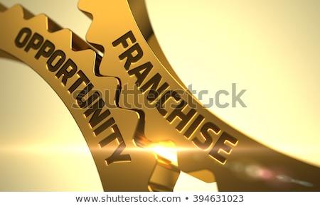 Golden Gears with Franchise Opportunity Concept. Stock photo © tashatuvango