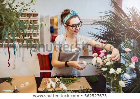 A business woman arranging flowers Stock photo © IS2