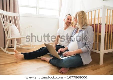 Couple in nursery Stock photo © IS2