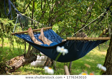 woman's feet hanging out of a swing Stock photo © IS2