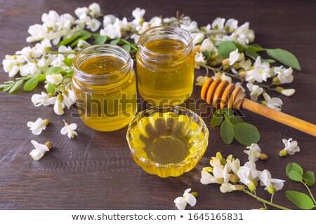 Honey with acacia blossoms Stock photo © grafvision