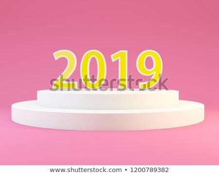 2019 New year symbol on white pedestal over pink background Stock photo © MikhailMishchenko