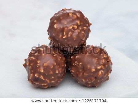 luxury chocolate candies with hazelnuts on marble board and white background stock photo © denismart