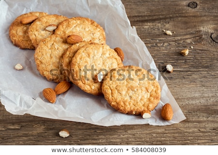homemade biscuit cookies with almond nuts and peanut butter on marble board on white kitchen table b stock photo © denismart