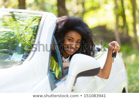 happy young woman with convertible car key Stock photo © dolgachov