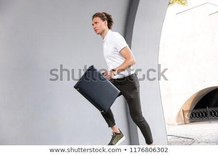 Kép komoly fürtös üzletember aktatáska fut Stock fotó © deandrobot