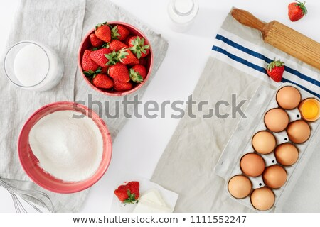 Raw ingredients for cooking strawberry pie or cake on rustic background. T Stock photo © Illia