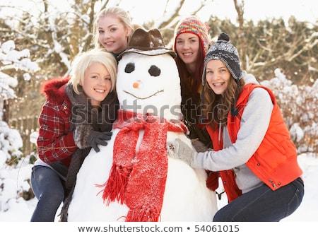 Grupo adolescente amigos edifício boneco de neve jardim Foto stock © monkey_business