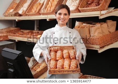 портрет женщины Бейкер свежие хлеб улыбаясь Сток-фото © boggy