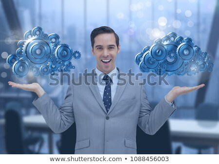 Businessman with open hands and cog gears clouds Stock photo © wavebreak_media