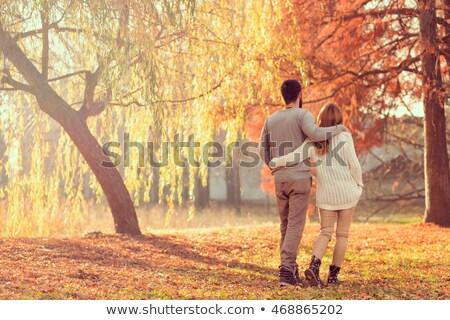 çift yürüyüş sonbahar park adam kadın Stok fotoğraf © robuart