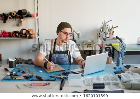 Processing applications on leather goods Stock photo © pressmaster