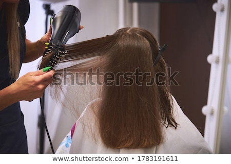 hairdresser with hair dryer drying male head Stock photo © dolgachov