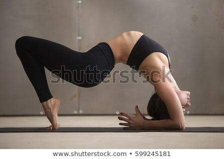 Woman doing Ashtanga Vinyasa Yoga asana Urdhva Dhanurasana Stock photo © dmitry_rukhlenko