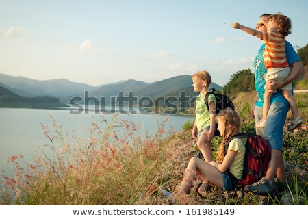 Family outdoor recreational activities, happy parent sitting with son and fishing, father and kid Stock photo © robuart