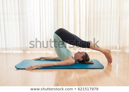 Yoga  Halasana (Plow Pose) Stock photo © lovleah
