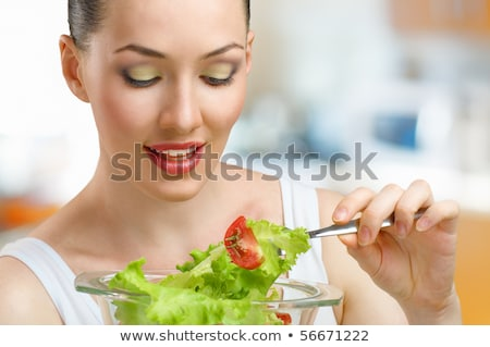Closeup portrait of a beautiful slender girl eating healthy food Stock photo © HASLOO