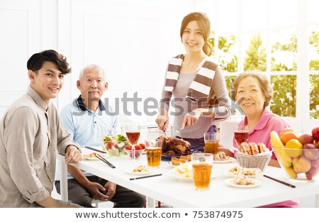 Two generations sitting in a restaurant Stock photo © photography33