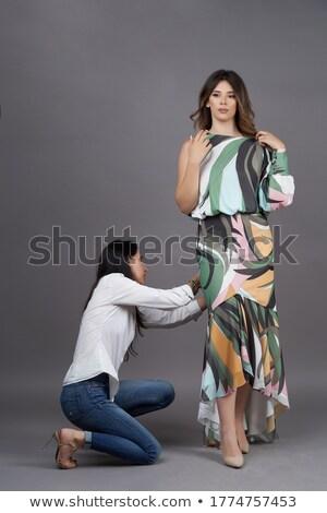 Female fashion designer pinning gray dress on model Stock photo © CandyboxPhoto
